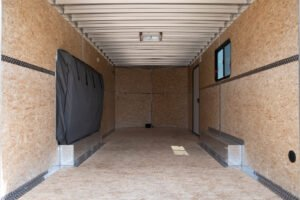 Interior of Thunder V Nose 8.5' Wide Tandem Axle Aluminum Cargo Trailer with Window Mattress