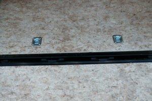 Hinge detail on rear ramp door of Legend Steel Cyclone 8.5' Wide Trailer