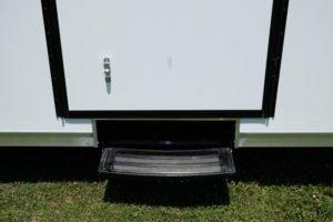 Slide Out Step Extended on Aluminum Enclosed Cargo Trailer Trailmaster Flat Front 8.5' Wide Model