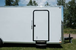 Curbside RV-Style Door on Aluminum Enclosed Cargo Trailer Trailmaster Flat Front 8.5' Wide Model
