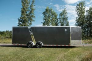 Side View of Tandem Axle Aluminum Enclosed Snow and Sport Trailer Model Trackmaster