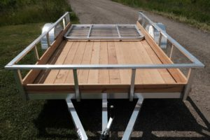 Front view of Legend's Aluminum Low Side Open Utility Trailer