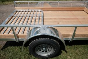 Single axle wheel and tire detail on Aluminum Open Low Side Utility Trailer