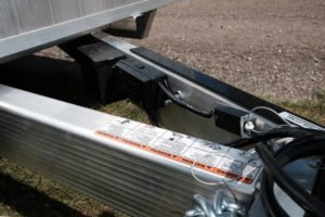 Tongue and electric detail on legend Open aluminum car hauler trailer