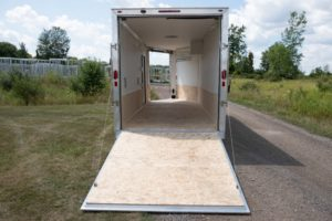 Rear Ramp Door and Interior View on Aluminum Enclosed Snow and Sport Trailer Trackmaster model