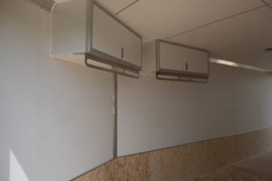 Overhead cabinets added to Trailmaster snow and sport enclosed trailer model