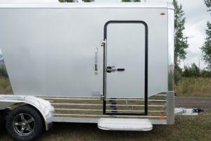 Curbside RV door of Legend Deluxe Tandem Axle Aluminum Enclosed Cargo Trailer