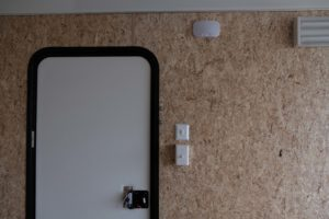Detail of Ramp Door and 12v Light with Switch on Legend Deluxe Tandem Axle Aluminum Enclosed Cargo Trailer