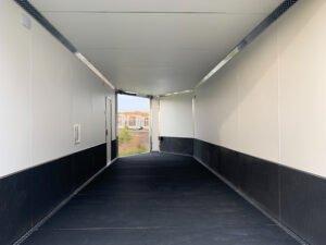 Interior View of Upgraded Flooring on Rear Ramp Door Extended on Front Ramp Door Open on Explorer Deck Over Snow Trailer