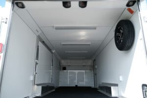 a Custom wheels and fender option on Legend trailers is this Aluminum Spare Tire Wall Mount