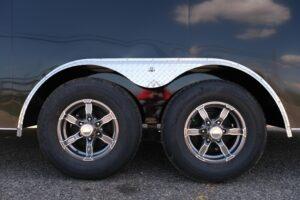 Photo of gunmetal aluminum 6 hole wheels a popular Custom wheels and fender option on Legend trailers