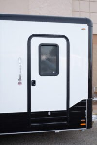 Enclosed Cargo and Sport trailer custom side door options Black nose and corners on blackout