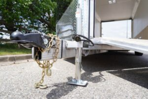 Jack and coupler detail on Deluxe Snow enclosed aluminum trailer